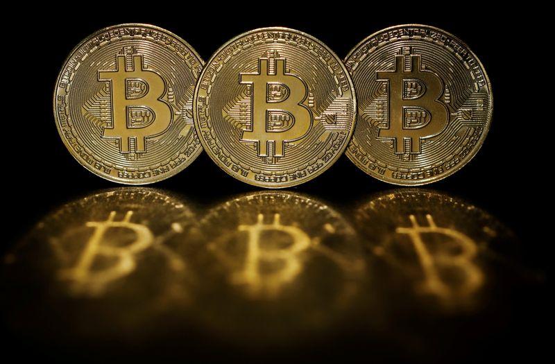 Bitcoin rises 9.8%